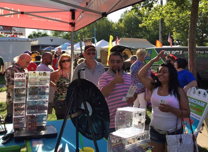 festival goers line up to spin the Prize Wheel
