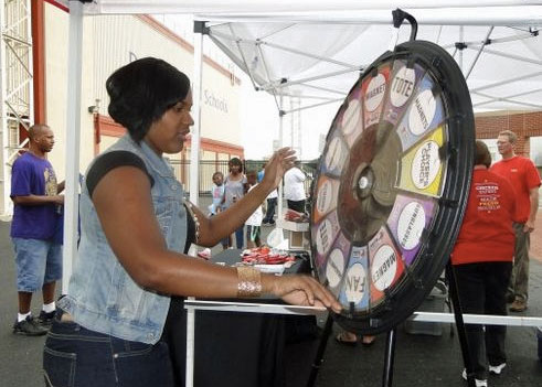 spinning the Prize Wheel at a football tailgate party