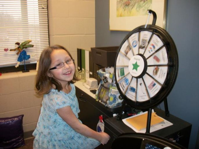 young girl takes a spin on the Prize Wheel