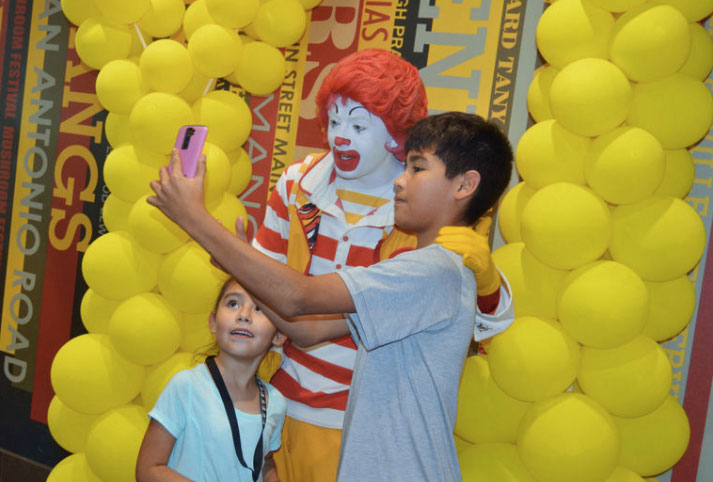 Kids take a selfie with Ronald McDonald in Madisonville, Texas