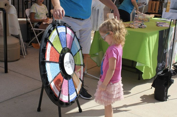 little girl spins prize wheel